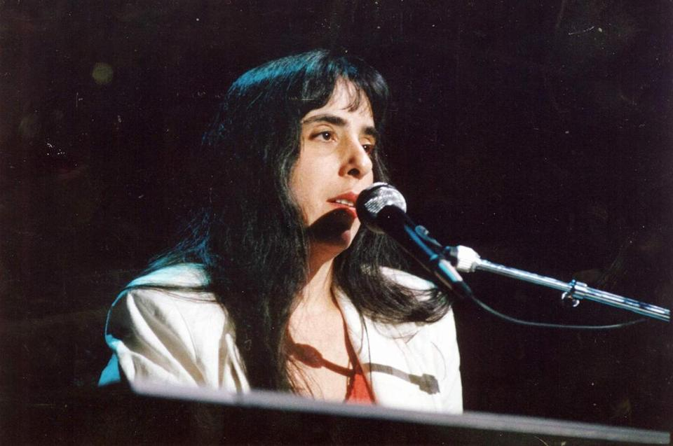 FILE--Laura Nyro is seen in this file photo from June 24, 1988, performing a song in Northhampton, Mass. Nyro, a singer-songwriter, who influenced a generation of women artists with songs like ``Eli's Coming'' and ``Stoned Soul Picnic'' and her intimate blend of pop, folk and jazz, has died at age 49, Tuesday, April 8, 1997, at her home in Danbury, Conn., of ovarian cancer. (AP Photo/Hartford Courant,Roland Otero) 17tycolumn
